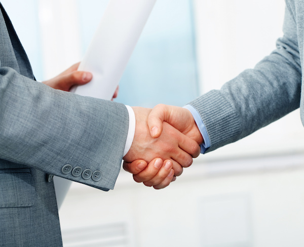 Close up of business handshake, grey and blue