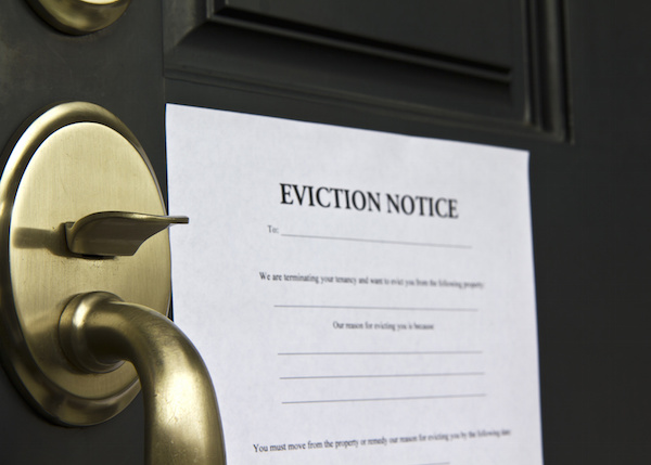 Eviction notice letter pasted on front door of house