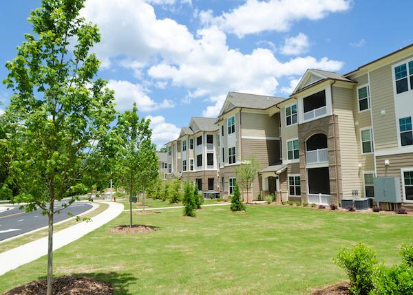 ypical apartment complex building in suburban area